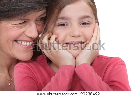 Little girl sitting with her grandmother - stock photo