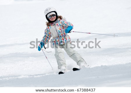 Little girl skiing downhill - ( space for text)