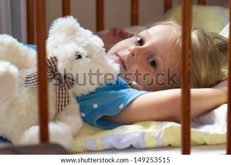 little girl  sleep in the bed - stock photo