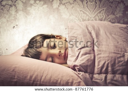 Little girl sleeping in bed - stock photo
