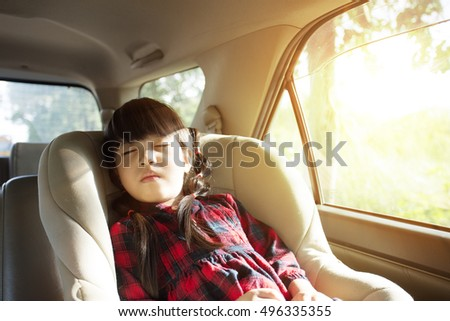 little girl sleeping in child car seat