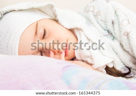 Little girl sleeping in her bed