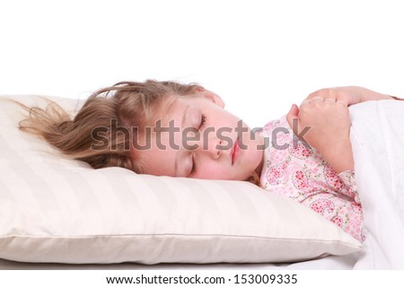 Little girl sleeps with a bear