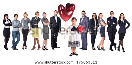 Little girl smile present gift red heart shaped box and balloons in hands. Little girl over big group of Business people on background - stock photo