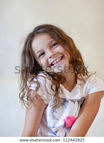 Little girl  smiles at the camera. - stock photo