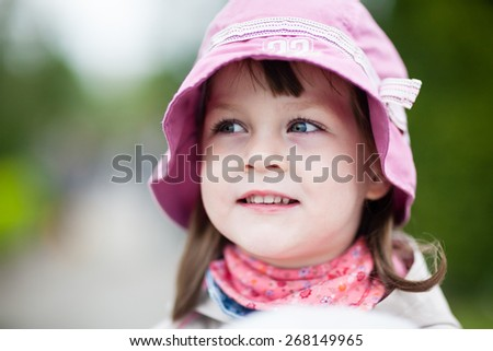 Little girl smiling - adorable young girl looking right - extremely shallow depth of field. Left eye of a girl is perfectly sharp. Creamy background - stock photo