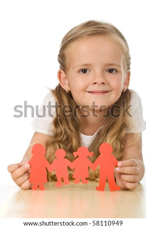 Little girl smiling and holding paper people - family concept