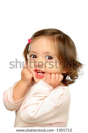 Little girl smiling at camera with a beautiful expression (portrait). More at my gallery