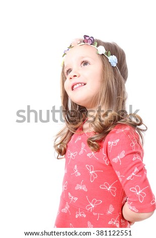 Little girl smiling expression looking up