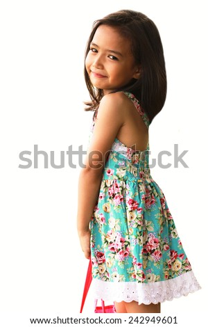 little girl smiling holding bags  - stock photo