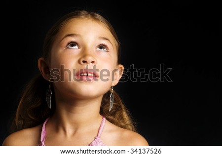 Little girl smiling looking up. - stock photo