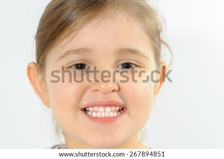 Little girl smiling with white teeth. - stock photo