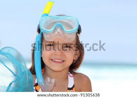Little girl snorkeling. - stock photo