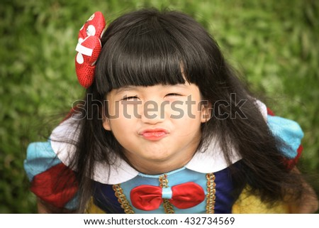 Little girl snow white with apple,Snow White's lovely. - stock photo