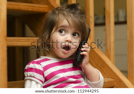 Little girl speak on the phone at home. Concept photo of long distance ,call ,communication, telephone, service, overseas, conversation, technology - stock photo
