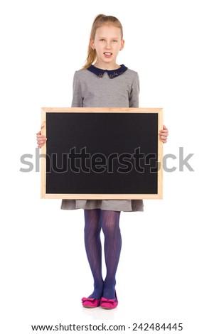 Little girl standing and holding a blackboard. Full length studio shot isolated on white. - stock photo