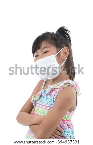 little girl standing in protective mask, white mask, on white background with copy space for health concept - stock photo