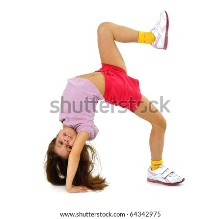Little girl standing on her arms - stock photo