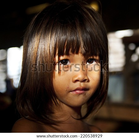 Little girl staring at the camera. - stock photo