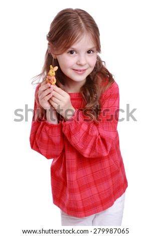 little girl statuette rabbit eastern on Holiday theme/Beautiful curly preschool girl with bunny in hands - stock photo
