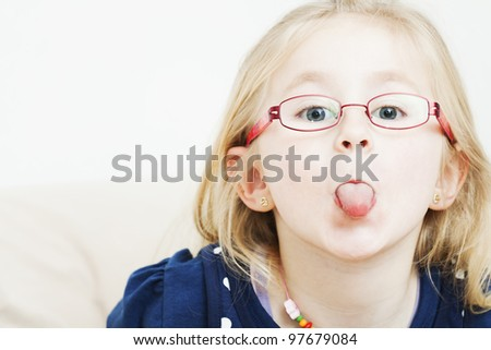 little girl sticking out her tongue - stock photo