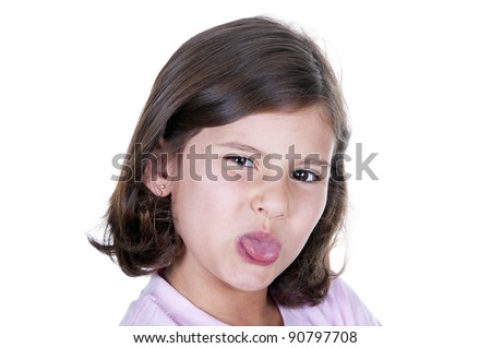 little girl sticking out her tongue on white background