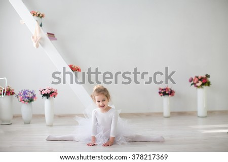 Little girl stretching. Little Ballerina. Flexible little girl ballerina doing gymnastic exercises. - stock photo