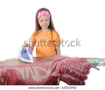 Little girl stroked evening dress. Isolated on white background - stock photo