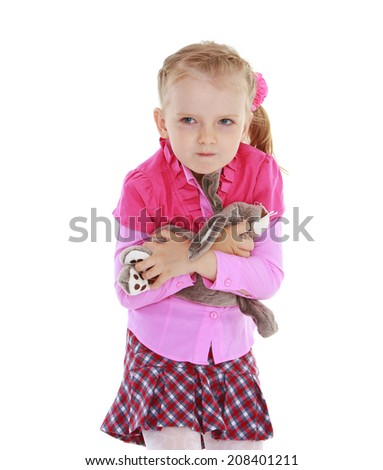 little girl strongly embraced her toy on a white background.kindergarten, the concept of childhood and joy, teens - stock photo