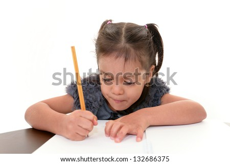 Little girl studying at the desk