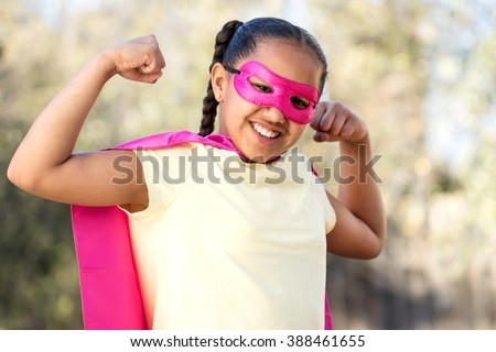 Little girl super hero - stock photo