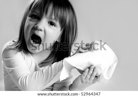 little girl surprised. holding roll of  toilet paper - stock photo