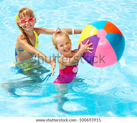 Little girl  swimming in pool. - stock photo
