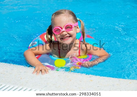 little girl swimming in the pool  in inflatable ring - stock photo