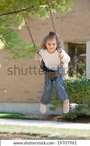 Little Girl Swinging - stock photo