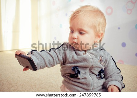 Little girl taken pictures of her self. Toned image.  - stock photo