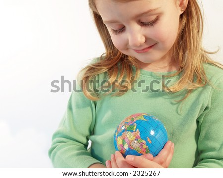 little girl taking good care of the Earth - stock photo