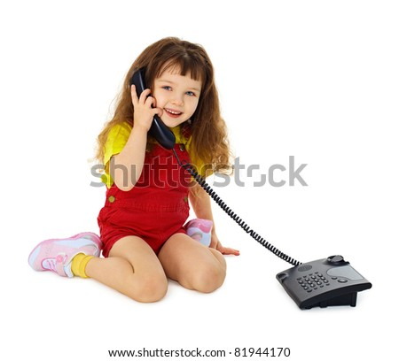 Little girl talking on phone - stock photo