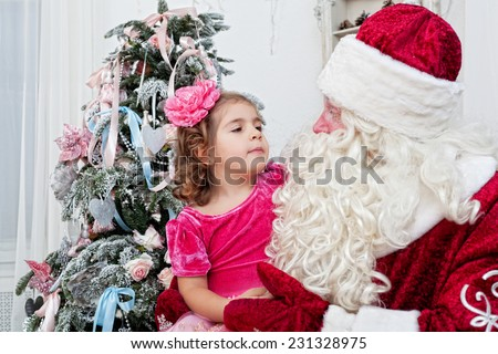 little girl talks to Saint Nicolas