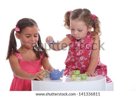 Little girl tea party - stock photo