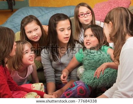Little girl tells a story at a sleepover - stock photo