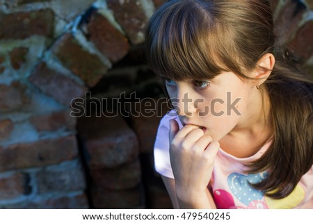 Little girl thinking about...