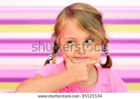 Little girl thinking gesture - stock photo
