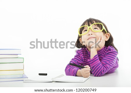little girl  thinking or dreaming during preparing homework - stock photo