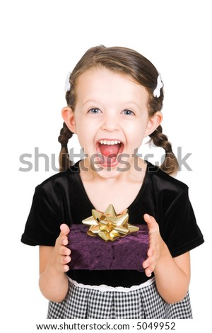 little girl thrilled with the gift she has received, isolated - stock photo