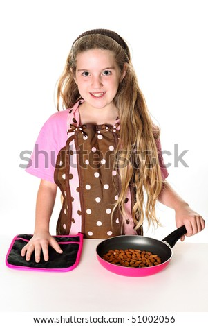 little girl toasting almonds