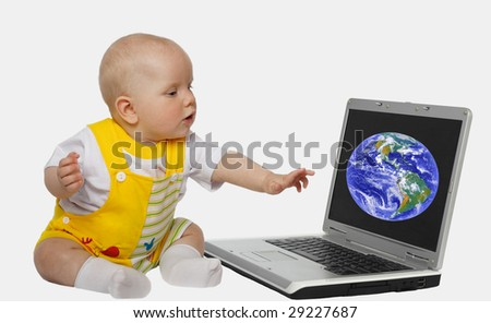 little girl touching screen on the laptop - stock photo