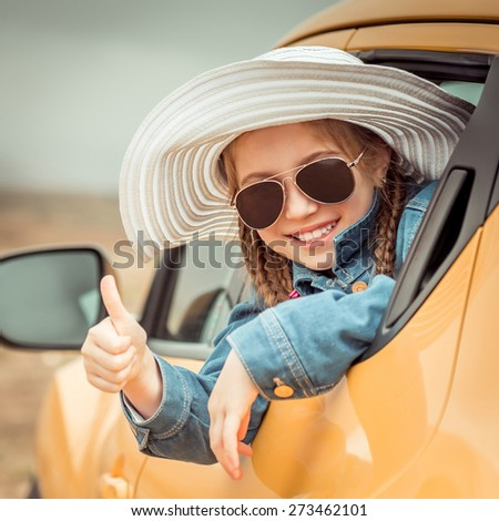 little girl traveling by car in the mountains close-up - stock photo