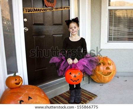 Little girl Trick-or-treating on Halloween - stock photo