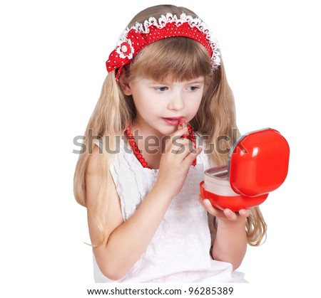 little girl trying makeup isolated on white background - stock photo